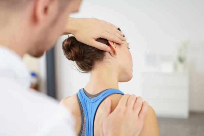 Frau bei einer Sportmassage